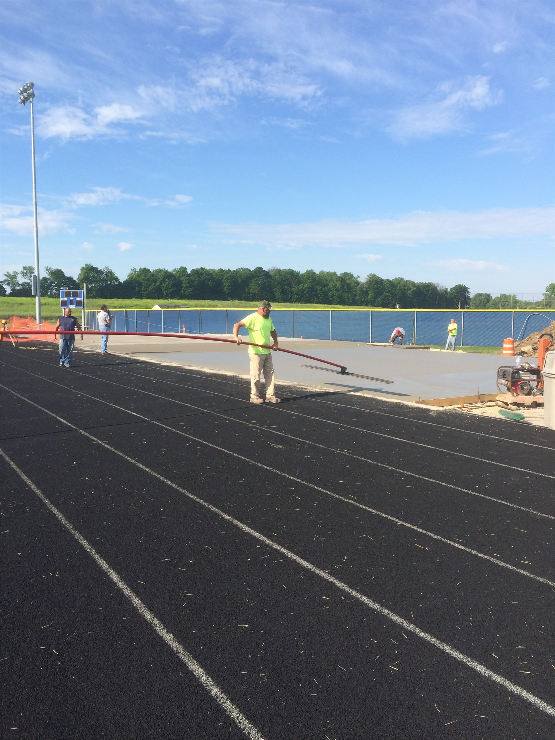 Pouring concrete pad for bleachers.